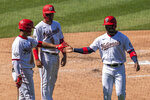 Washington Nationals' Victor Robles, right, is congratulated by teammate Juan Soto, left, after scoring a run on Trea Turner's two-run double during the fifth inning of a baseball game against the Atlanta Braves in Washington, Sunday, Sept. 13, 2020. (AP Photo/Manuel Balce Ceneta)