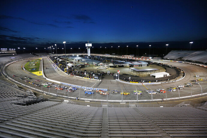 NASCAR Cup Series 63rd Annual Federated Auto Parts 400 at Richmond Raceway, Saturday 9/12/2020. Cars take the first turn amidst empty seats to begin a NASCAR Cup Series auto race Saturday, Sept. 12, 2020, in Richmond, Va. (James Wallace/Richmond Times-Dispatch via AP)