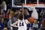 Santa Clara guard Jalen Williams, left, dunks over Gonzaga forward Corey Kispert during the second half of an NCAA college basketball game in Spokane, Wash., Thursday, Feb. 25, 2021. (AP Photo/Young Kwak)