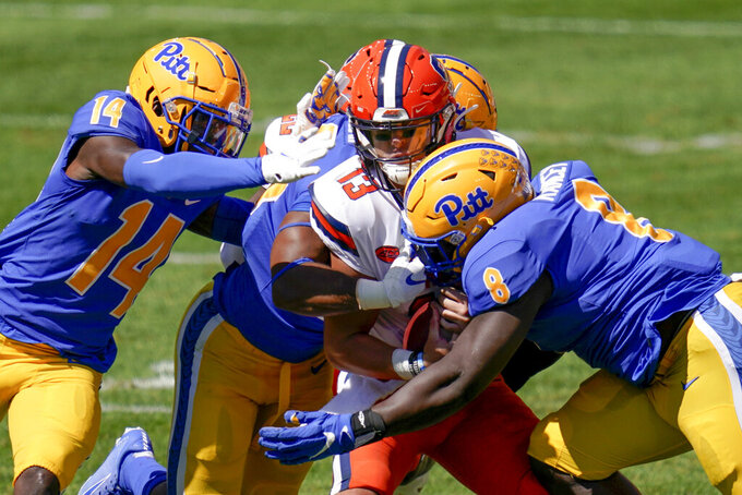 Syracuse quarterback Tommy DeVito (13) is sacked by Pittsburgh defensive lineman Calijah Kancey (8) and defensive back Marquis Williams (14) during the first half of an NCAA college football game, Saturday, Sept. 19, 2020, in Pittsburgh. (AP Photo/Keith Srakocic)