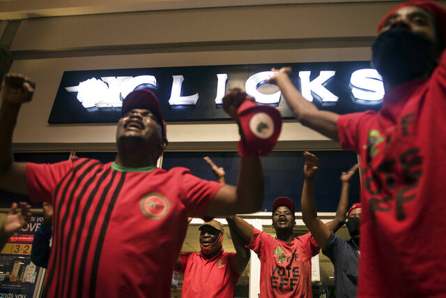 Economic Freedom Fighters (EFF) supporters protest outside a Clicks store in Soweto, Johannesburg, Monday, Sept. 7 2020 calling for the closure of the stores around the country. The chain store posted an advertisement on their website that negatively described natural Black hair labelled as being