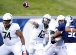 Baylor quarterback Charlie Brewer (12) throws a pass behind offensive lineman Prince Pines (74) as Rice defensive lineman Elijah Garcia (92) tries to break past offensive lineman Jake Fruhmorgen during the first half of an NCAA college football game Saturday, Sept. 21, 2019, in Houston. (AP Photo/Michael Wyke)