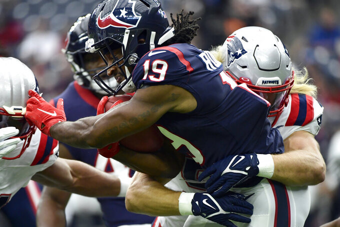 Houston Texans' Andre Roberts (19) is tackled by New England Patriots' Chase Winovich during the first half of an NFL football game Sunday, Oct. 10, 2021, in Houston. (AP Photo/Justin Rex)