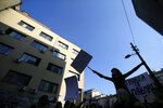 High-school students protest in front of main police station in Belgrade, Serbia, Monday, March 18, 2019. Dozens of high-school students have staged a sit-down protest demanding that the authorities release from detention a fellow-student who was jailed during weekend anti-government protests in Serbia. (AP Photo/Darko Vojinovic)