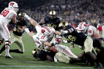 Wisconsin running back Garrett Groshek (37) dives in for a touchdown in front of Purdue defensive tackle Ray Ellis (96) during overtime of an NCAA college football game in West Lafayette, Ind., Saturday, Nov. 17, 2018. Wisconsin defeated Purdue 47-44 in overtime. (AP Photo/Michael Conroy)