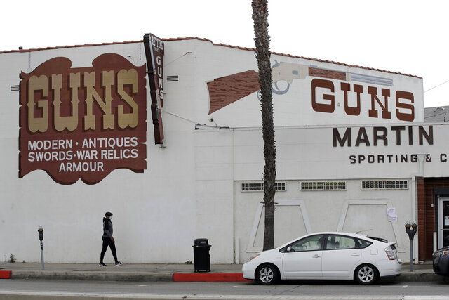 CORRECTS TO CULVER CITY, INSTEAD OF LOS ANGELES Guns are advertised for sale at a gun shop Tuesday, March 24, 2020, in Culver City, Calif. Los Angeles County Sheriff Alex Villanueva said he would like to see gun shops shut down.