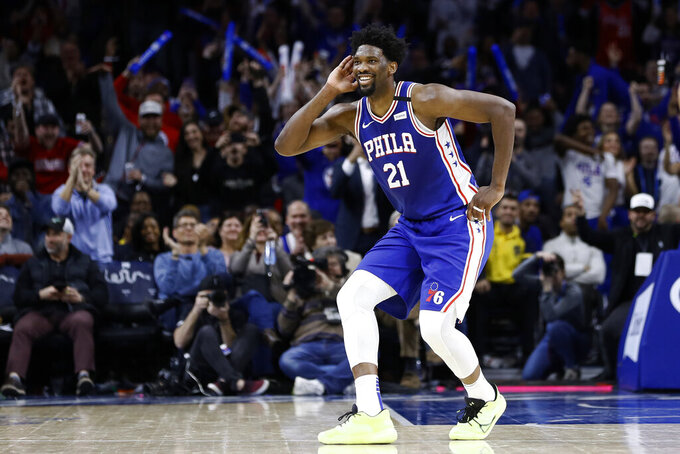 FILE - In this Feb. 24, 2020, file photo, Philadelphia 76ers' Joel Embiid celebrates after a three-point basket during the second half of an NBA basketball game against the Atlanta Hawks in Philadelphia. 76ers coach Brett Brown says All-Stars Ben Simmons and Joel Embiid are healthy for the NBA restart. (AP Photo/Matt Slocum, File)