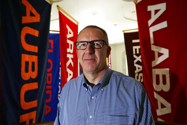 FILE - In this May 23, 2016, file photo, Southeastern Conference commissioner Greg Sankey poses in Birmingham, Ala. There are 130 major college football teams, spread across 41 states and competing in 10 conferences, save for a handful of independents. The goal is to have all those teams start the upcoming season at the same time — whether that's around Labor Day as scheduled or later — and play the same number of games.(AP Photo/Brynn Anderson, File)