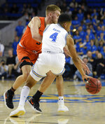 UCLA guard Jaylen Hands, front, steals the ball away from Oregon State forward Tres Tinkle during the first half of an NCAA college basketball game in Los Angeles, Thursday, Feb. 21, 2019. (AP Photo/Kelvin Kuo)