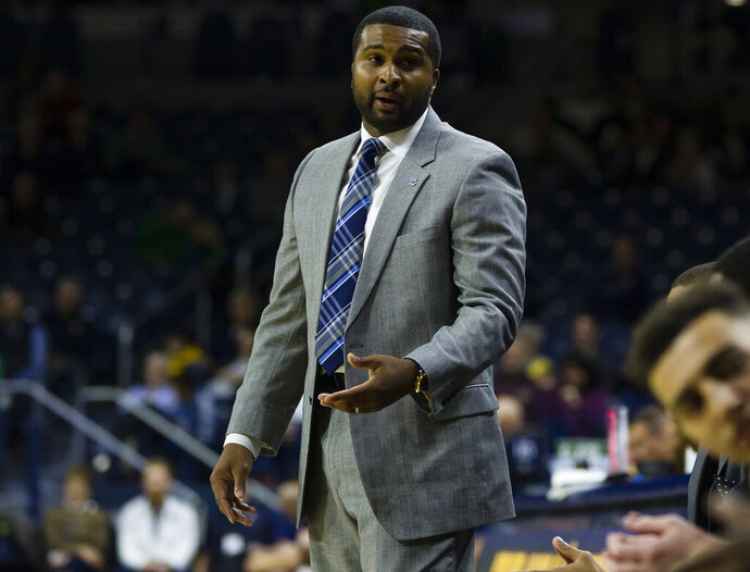 Presbyterian's head coach Quinton Ferrell talks to the bench during an NCAA college basketball game against Notre Dame Monday, Nov. 18, 2019, in South Bend, Ind. (Michael Caterina/South Bend Tribune via AP)