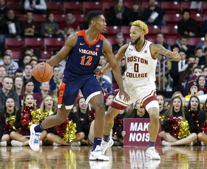 Virginia guard De'Andre Hunter (12) drives against Boston College guard Ky Bowman (0) during the second half of an NCAA basketball game Wednesday, Jan. 9, 2019, in Boston. (AP Photo/Mary Schwalm)
