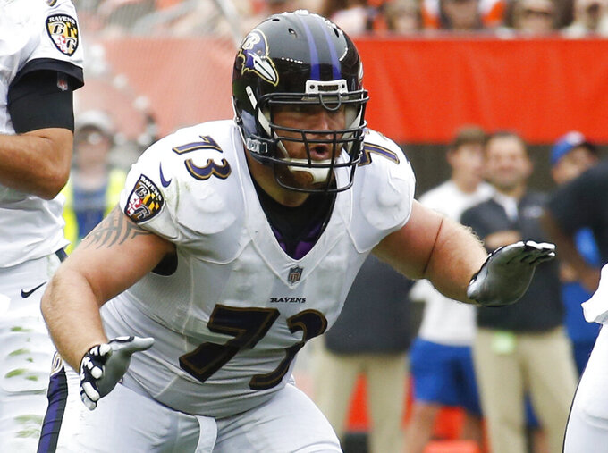 FILE - In this Oct. 7, 2018, file photo, Baltimore Ravens offensive guard Marshal Yanda (73) plays against the Cleveland Browns during the first half of an NFL football game in Cleveland. Yanda retired from the NFL on Wednesday, March 11, 2020, with the satisfaction of knowing that he walked away before being kicked out the door. (AP Photo/Ron Schwane, File)