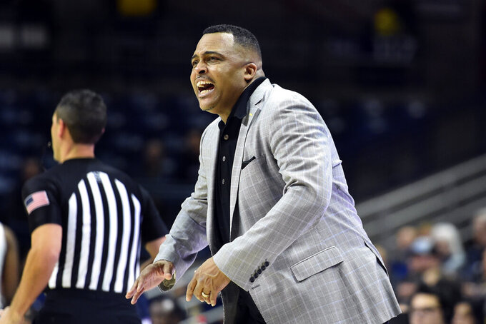 Tulane coach Ron Hunter yells to his team during the second half of an NCAA college basketball game against Connecticut on Wednesday, Jan. 8, 2020, in Storrs, Conn. (AP Photo/Stephen Dunn)