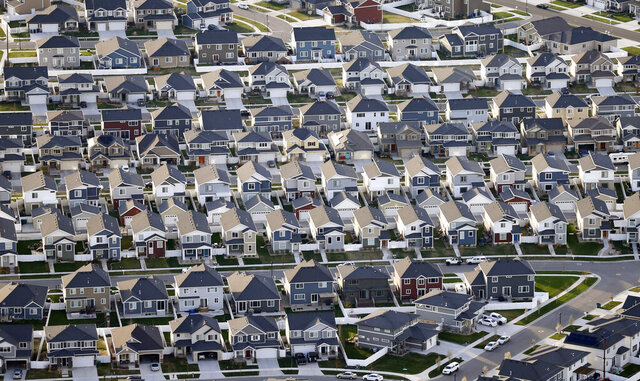 FILE - This April 13, 2019, file photo, shows rows of homes, in suburban Salt Lake City. Trump is hoping he can shore up support in America's suburbs by promising to protect them from the unrest and violence in Democratically led cities. But many suburbanites and even GOP strategists say the president may be misreading the mood in areas critical to his reelection. (AP Photo/Rick Bowmer, File)