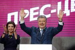 Ukrainian President Petro Poroshenko and his wife Maryna greet their supporters at his headquarters after the second round of presidential elections in Kiev, Ukraine, Sunday, April 21, 2019. Ukrainian President Petro Poroshenko is accepting defeat in the election for the country's top post. (AP Photo/Efrem Lukatsky)