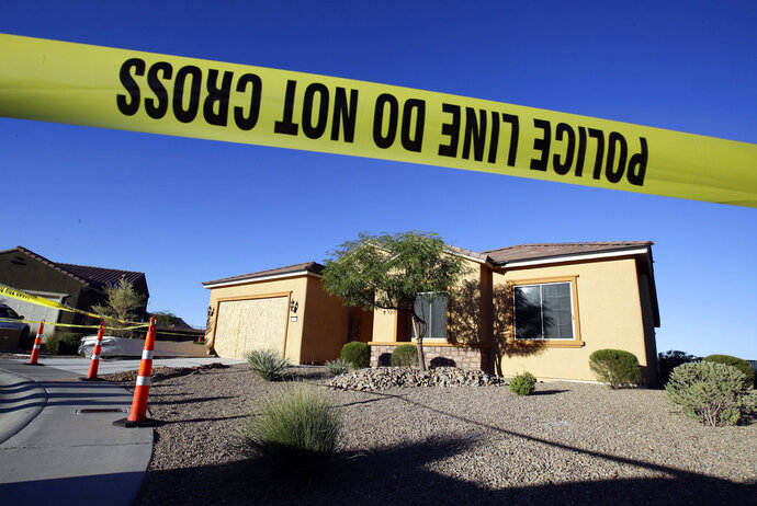 FILE - In this Oct. 2, 2017 file photo, police tape blocks off the home of Stephen Craig Paddock in Mesquite, Nev. The house of the man responsible for the deadliest mass shooting in modern U.S. history has been sold. Court records show District Judge Gloria Sturman approved the sale of Paddock's Mesquite home for $425,000 to Daniel and Bernadette Jones. Proceeds will go to victims of the Oct. 1, 2017, shooting that killed 58 people. (AP Photo/Chris Carlson, File)