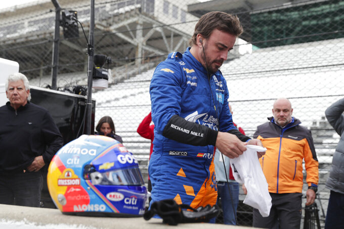 IndyCar driver Fernando Alonso, of Spain, prepares to drive during testing at the Indianapolis Motor Speedway in Indianapolis, Wednesday, April 24, 2019. (AP Photo/Michael Conroy)