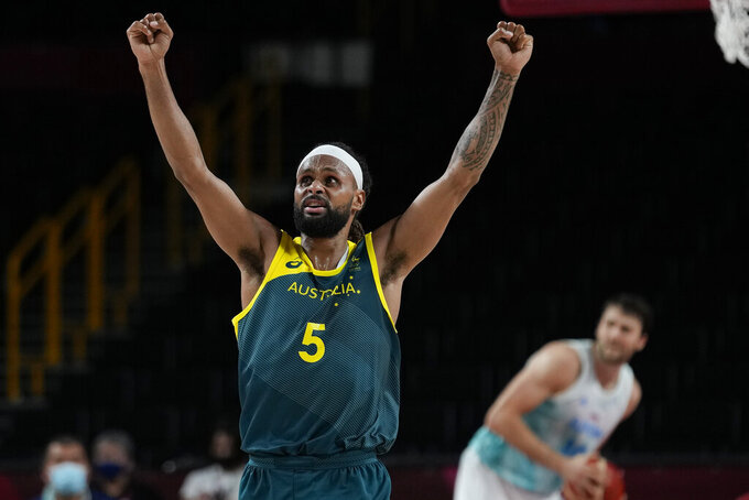 Australia's Patty Mills (5) reacts as time runs down against Slovenia during the men's bronze medal basketball game at the 2020 Summer Olympics, Saturday, Aug. 7, 2021, in Tokyo, Japan. (AP Photo/Eric Gay)