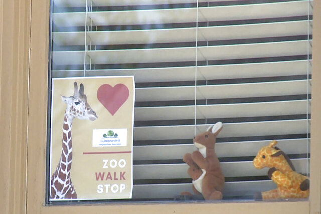 "In this image taken from video provided by WKYT-TV, stuffed animals are displayed in the window of a home in the Cumberland neighborhood of Lexington, Ky. A Kentucky town has launched a neighborhood ""safari"" for children during the coronavirus pandemic by displaying stuffed animals in their windows. WKYT-TV reports the ""Cumberland Hill Zoo Walk"" was kicked off Sunday morning, March 29, 2020, in Lexington after dozens of houses in the community signed up to showcase their zoo animals as part of the effort. (WKYT-TV via AP)"