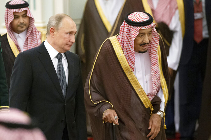 Russian President Vladimir Putin, center left, and Saudi Arabia's King Salman, right, attend the official welcome ceremony in Riyadh, Saudi Arabia, Monday, Oct. 14, 2019. (AP Photo/Alexander Zemlianichenko, Pool)