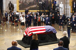 House Speaker Nancy Pelosi of Calif., second from left, attends a memorial service as the flag-draped casket of Rep. John Lewis, D-Ga., lies in state at the Capitol Rotunda, Monday, July 27, 2020, in Washington.  (Shawn Thew/Pool via AP)