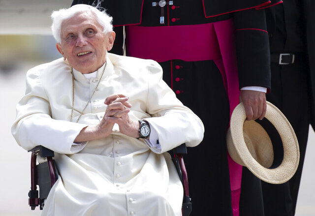 Emeritus Pope Benedict XVI arrives for his departure at Munich Airport in Freising, Germany, Monday June 22, 2020. Emeritus Pope Benedict XVI is returning to the Vatican after a four-day visit to Germany to visit his ailing elder brother. (Sven Hoppe/dpa via AP)