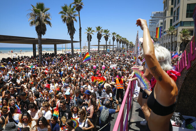People participate in the annual Pride Parade, in Tel Aviv, Israel, Friday, June 25, 2021. Tens of thousands of people attended the parade on Friday in one of the largest public gatherings held in Israel since the onset of the coronavirus pandemic. (AP Photo/Ariel Schalit)