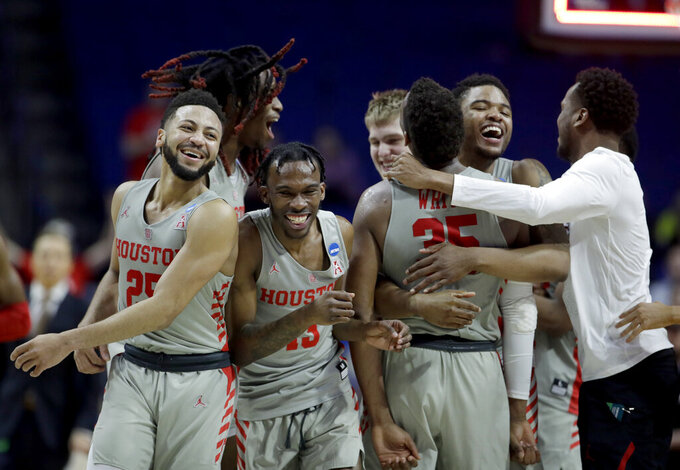 Houston players celebrate after their second round men's college basketball game against Ohio State in the NCAA Tournament Sunday, March 24, 2019, in Tulsa, Okla. Houston won 74-59. (AP Photo/Charlie Riedel)