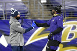 Dallas Cowboys linebacker Justin March, left, wears his My Cause My Cleats special cleats, while shaking hands with Baltimore Ravens wide receiver Dez Bryant prior to an NFL football game, Tuesday, Dec. 8, 2020, in Baltimore. (AP Photo/Nick Wass)