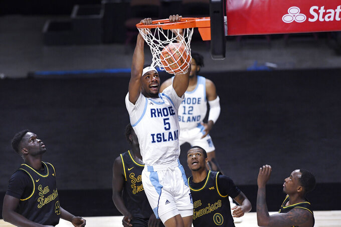 Rhode Island's Antwan Walker (5) dunks against San Francisco in the second half of an NCAA college basketball game, Sunday, Nov. 29, 2020, in Uncasville, Conn. (AP Photo/Jessica Hill)