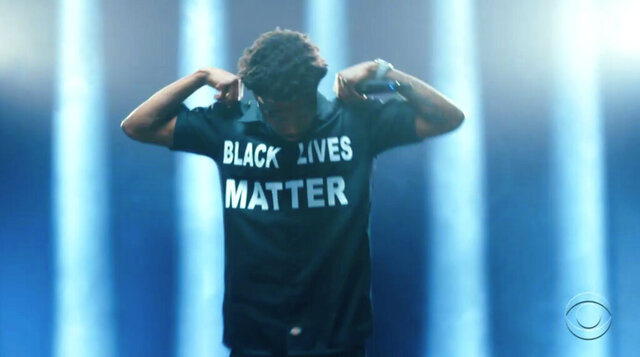 In this video grab issued Sunday, June 28, 2020, by BET, Roddy Ricch wears a shirt that says Black Lives Matter while performing during the BET Awards. (BET via AP)