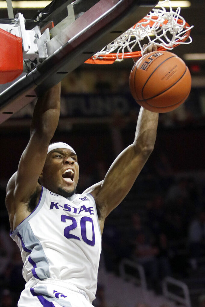 Kansas State forward Xavier Sneed dunks during the second half of an NCAA college basketball game against Iowa State in Manhattan, Kan., Saturday, March 7, 2020. Sneed scored 31 points in the game. Kansas State defeated Iowa State 79-63. (AP Photo/Orlin Wagner)