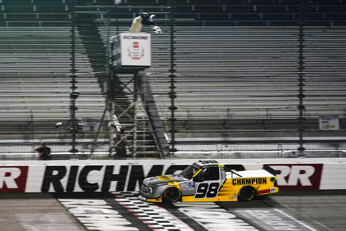 Grant Enfinger crosses the finish line to win the NASCAR Truck Series auto race Thursday, Sept. 10, 2020, in Richmond, Va. (AP Photo/Steve Helber)