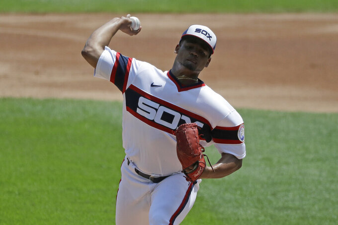 Chicago White Sox starting pitcher Reynaldo Lopez throws against the Minnesota Twins during the first inning of a baseball game in Chicago, Sunday, July 26, 2020. (AP Photo/Nam Y. Huh)