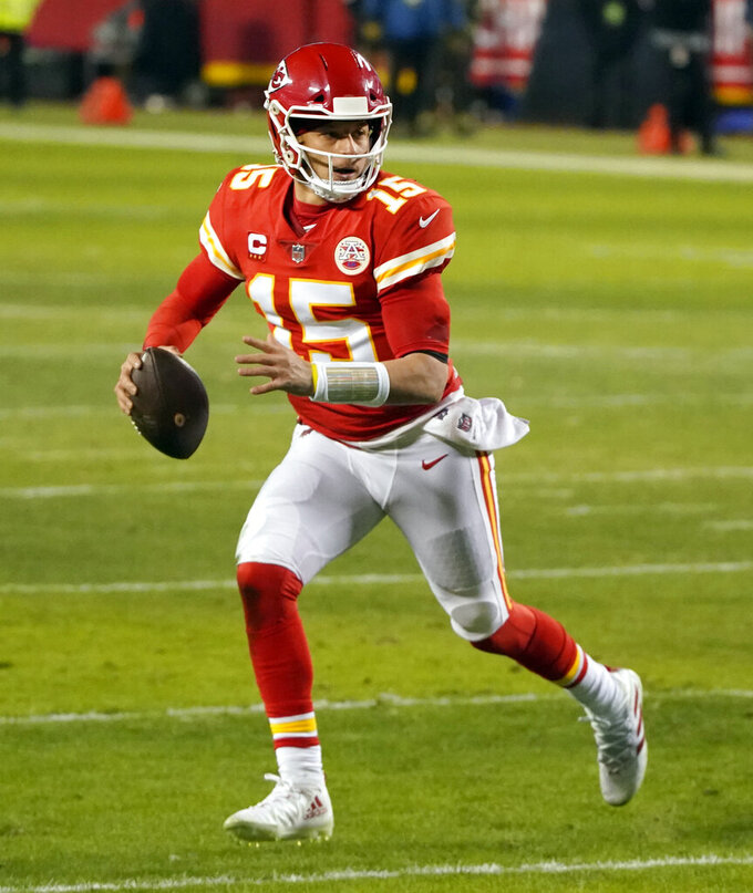 Kansas City Chiefs quarterback Patrick Mahomes scrambles up field during the second half of the AFC championship NFL football game against the Buffalo Bills, Sunday, Jan. 24, 2021, in Kansas City, Mo. (AP Photo/Charlie Riedel)
