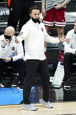 Indiana head coach Archie Miller questions a call during the first half of an NCAA college basketball game against Rutgers at the Big Ten Conference tournament, Thursday, March 11, 2021, in Indianapolis. (AP Photo/Darron Cummings)