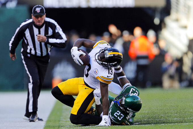 Pittsburgh Steelers wide receiver James Washington (13) is brought down by New York Jets cornerback Arthur Maulet (23) in the first half of an NFL football game, Sunday, Dec. 22, 2019, in East Rutherford, N.J. (AP Photo/Adam Hunger)