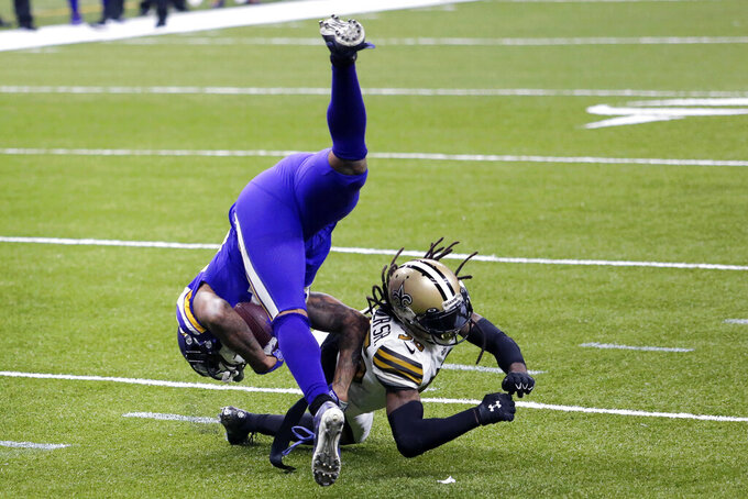 New Orleans Saints free safety D.J. Swearinger (36) upends Minnesota Vikings tight end Irv Smith in the second half of an NFL football game in New Orleans, Friday, Dec. 25, 2020. The Saints won 52-33. (AP Photo/Brett Duke)