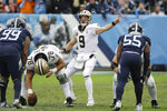 New Orleans Saints quarterback Drew Brees (9) calls a play against the Tennessee Titans in the first half of an NFL football game Sunday, Dec. 22, 2019, in Nashville, Tenn. (AP Photo/James Kenney)