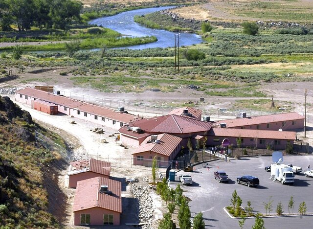 FILE - This Friday, July 1, 2005, file photo, shows the Mustang Ranch in the Truckee River canyon near Patrick, Nev. The legal brothel in northern Nevada is eligible to apply for a small business grant under a federal coronavirus relief package, county officials have decided. The Mustang Ranch, the only brothel in Storey County, is owned by a county commissioner, Lance Gilman. Local governments are allowed to use their share of the $150 billion in state and local government aid in the CARES Act to offer grants reimbursing businesses for costs related to the pandemic and the shutdown. (AP Photo/Debra Reid, File)