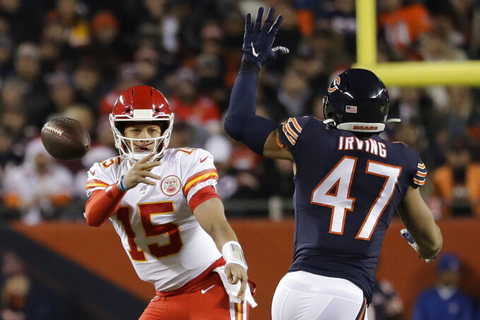 Kansas City Chiefs quarterback Patrick Mahomes (15) throws as Chicago Bears linebacker Isaiah Irving (47) tries to deflect the ball in the first half of an NFL football game in Chicago, Sunday, Dec. 22, 2019. (AP Photo/Nam Y. Huh)