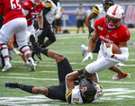 Appalachian State defensive back Ryan Huff (21) stops South Alabama wide receiver Kawaan Baker (15) during the first half of an NCAA college football game Saturday, Oct. 26, 2019, at Ladd-Peebles Stadium in Mobile, Ala. (AP Photo/Julie Bennett)