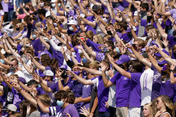 Kansas State students cheer during the second half of an NCAA college football game against Arkansas State, Saturday, Sept. 12, 2020, in Manhattan, Kan. (AP Photo/Charlie Riedel)