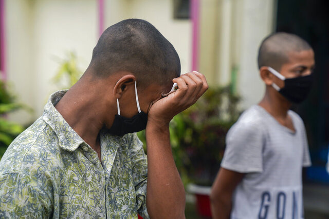 In this May 20, 2020, photo, provided by UNICEF, Mohammed Rakib, 15, who was accused of beating a man and sent to an overcrowded detention center, cries before being released, in Tongi, on the outskirts of Dhaka, Bangladesh. Authorities in Bangladesh have been releasing hundreds of children suspected of committing mostly petty crimes as they try to keep the coronavirus from spreading in overcrowded detention centers, officials said Friday. The orders for their release on bail came from virtual courts set up by the country's Supreme Court with the help of UNICEF, officials said.