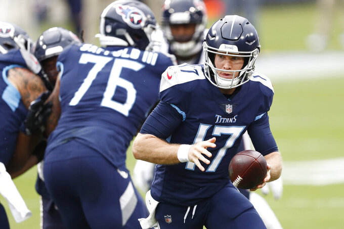 Houston Texans wide receiver Chad Hansen (17) hands the ball off against the Houston Texans in the first half of an NFL football game Sunday, Oct. 18, 2020, in Nashville, Tenn. (AP Photo/Wade Payne)