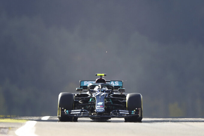 Mercedes driver Valtteri Bottas of Finland steers his car during the third practice session for the Eifel Formula One Grand Prix at the Nuerburgring racetrack in Nuerburg, Germany, Saturday, Oct. 10, 2020. The Germany F1 Grand Prix will be held on Sunday. (AP Photo/Matthias Schrader, Pool)