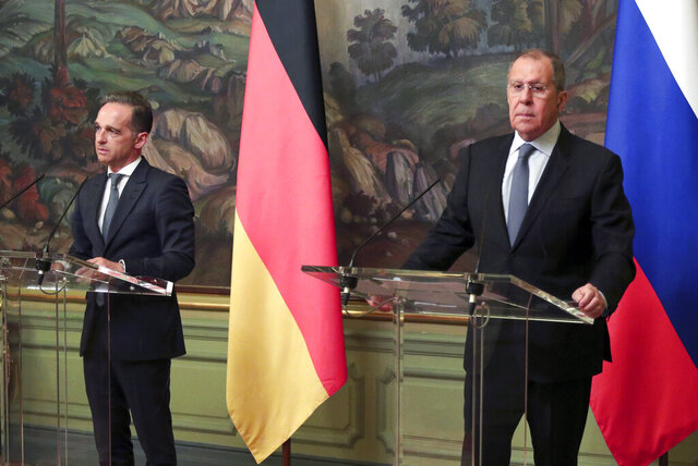 Russian Foreign Minister Sergey Lavrov, right, and German Foreign Minister Heiko Maas, attend a joint news conference following their talks in Moscow, Russia, Tuesday, Aug. 11, 2020. (Russian Foreign Ministry Press Service via AP)