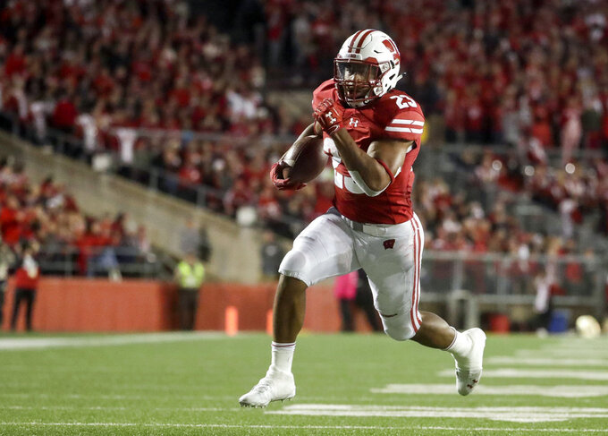 FILE - In this Saturday, Oct. 6, 2018, file photo, Wisconsin's Jonathan Taylor runs for a touchdown during the second half of an NCAA college football game against Nebraska in Madison, Wis. The Badgers need consistent production from Taylor at the Big House. (AP Photo/Morry Gash, File)