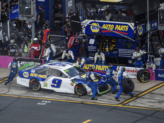 Chase Elliott (9) makes a pit stop during a NASCAR Cup Series auto race at Charlotte Motor Speedway, Sunday, Sept. 29, 2019, in Concord, N.C. (AP Photo/Mike McCarn)