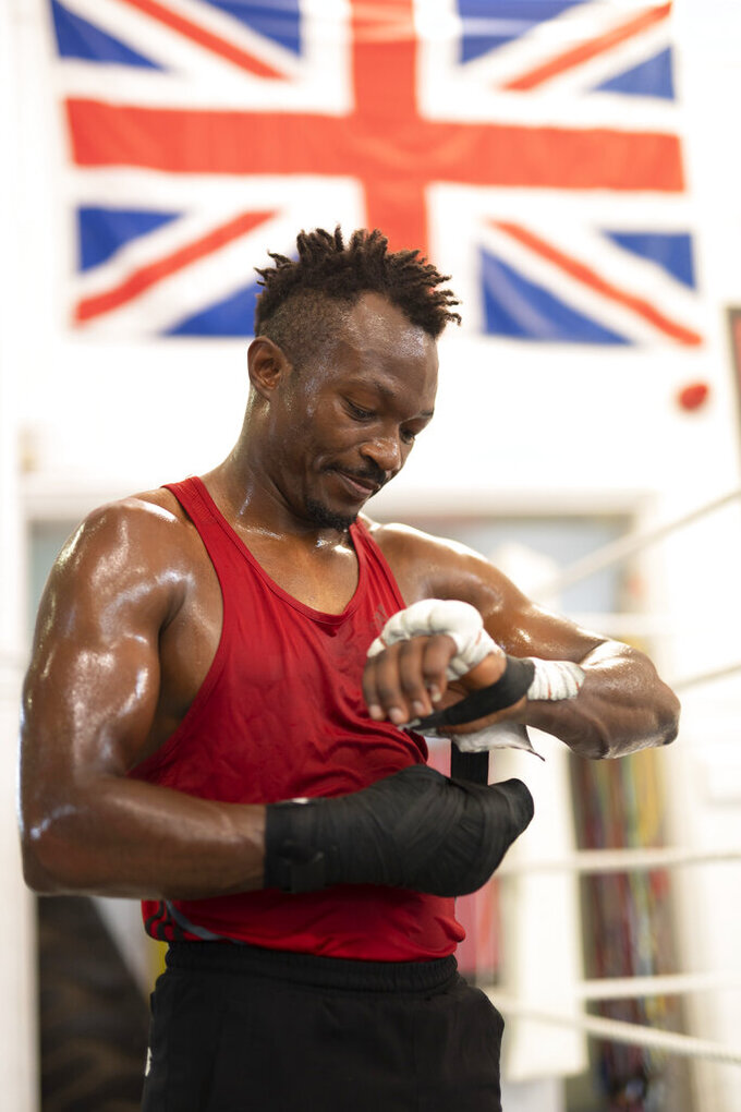 Boxer Thomas Essomba trains at Steel City Gym in Sheffield, England, Thursday, Aug. 4, 2021. Cameroonian boxer Thomas Essomba, was one of seven people who defected at London 2012. Nine years on, he talks to AP about what it's been like to live with that decision. (AP Photo/Jon Super)